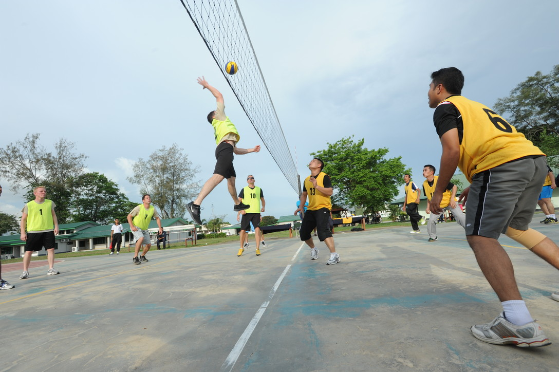 U.S. Air Force and Royal Malaysian Air Force airmen compete in volleyball as part of Cope Taufan 2012 at TUDM Butterworth April 12, 2012. The airmen competed in soccer, volleyball and sepak takraw, a traditional Malaysian sport, as part of a camaraderie and friendship building event. Sports have long played and important role in building esprit de corps and physical fitness in both countries militaries. Cope Taufan is a live-flying exercise designed around dissimilar basic fighter maneuvers and dissimilar air combat tactics training. (U.S. Air Force photo/Master Sgt. Matt Summers)